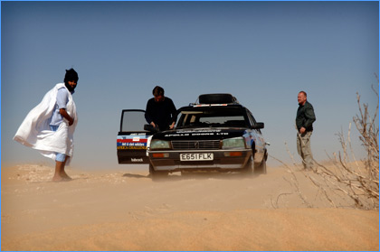Timbuktu Challenge car and team pictured in the desert